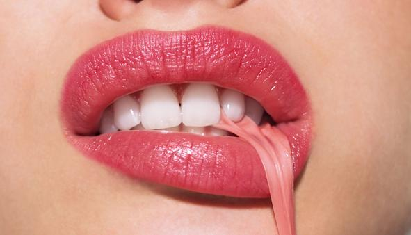 Woman pulling gum with mouth Model Released